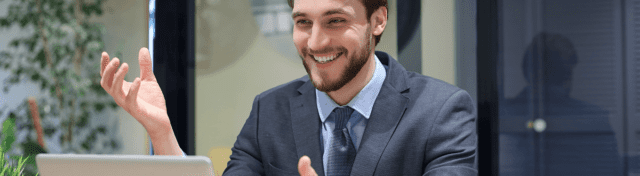 Young man in suit doing an online pitch to investors