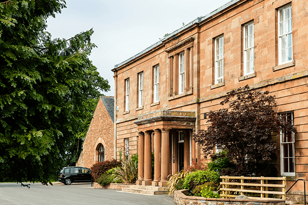 The front exterior of the Greenhill Hotel