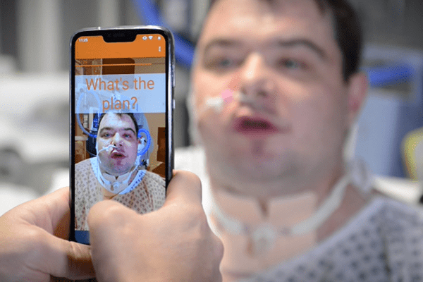 Liopa's app being used on a smartphone to read a male patient's lip movements
