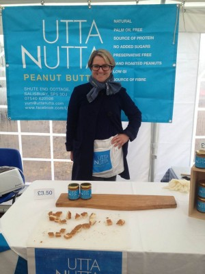 Katie Sargent, the owner of Utta Butter peanut butter stood behind a stand selling he product