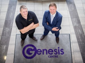 2 men from Genesis Centre stood crossing their arms smiling and looking upwards