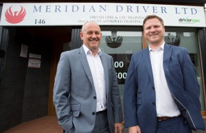 2 men in suits stood outside of the Meridian Driver Limited office
