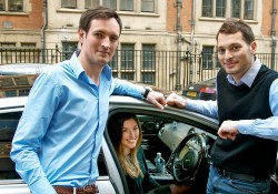 Two male co-founders of carwow stood next to a car