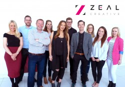 A group of employees from Zeal Creative smiling