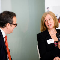 A man and a woman speaking at the BBB Vital Ingredient for Growth event