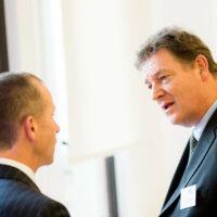 2 men in suits talking