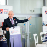 A man stood on stage delivering a speech at the BBB Vital Ingredient for High Growth Event