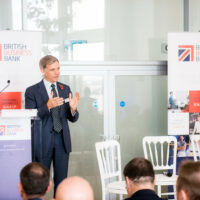 A man delivering a speech at the BBB Vital Ingredient for High Growth Event