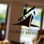 The logo of Brunel's SS Great Britain on a glass door