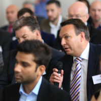 A man asking a question at the BBB Vital Ingredient for High Growth Event