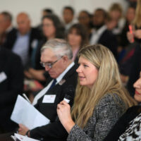 A woman asking a question at the BBB Vital Ingredient for High Growth Event
