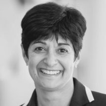 A head shot of Neeta Atkar - Senior Independent Director and Chair of Risk Commitee