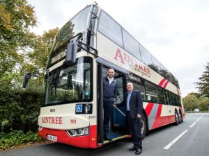 A double-decker bus with Aintree Enterprise branding