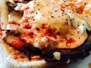 Close up of seasoned eggs on toast from Old School BBQ Bus