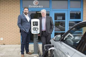 Electric vehicle being charged in front of Elmtronics offices