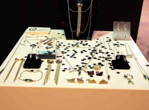 A selection of jewelry on display on a table
