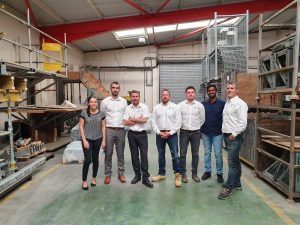 Employees from Fast-Form stood in a warehouse