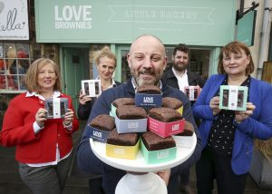 Employees stood outside of the Love Brownies bakery holding a variety of brownies