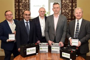 5 men in suits stood around a table showing the Aurelius products