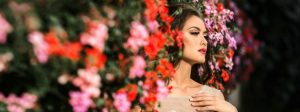A model for Brides 4 Less stood in a wall of flowers