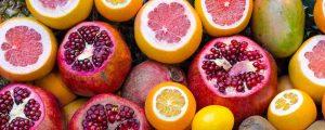 A selection of fruit including oranges, mangos, grapefruits and pomegranates