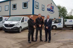 Three men stood outside the Sleaford Building Services office