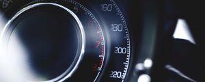 A close up of a speedometer in a car
