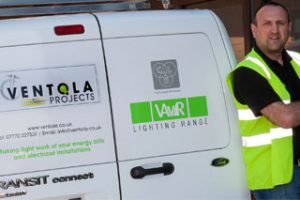 Man in a Hi Vis vest standing next to a Ventola Projects van