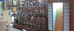 A selection of kitchen taps on display in a shop