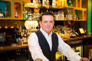 Scott Matthews, CEO of DC Bars, behind the bar in one of his premises