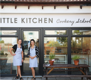 Little Kitchen's two co-owners, Madeleine and Claire, standing outside the front of the cookery school building