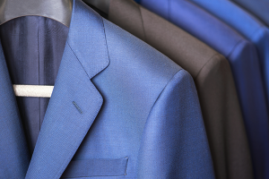 Close-up of tailored gentlemen's suits hanging on a rack