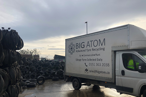 One of Big Atom's white vans collecting waste tyres from a recycling yard