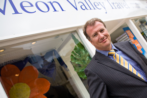 James Beagrie, managing director of Meon Valley Travel, standing outside his business premises