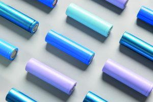 Close-up of colourful used rechargeable Nickel Metal Hydride (Ni-MH) battery on grey background