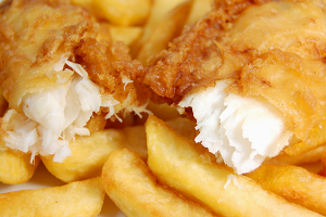 Close-up of chip shop-style battered cod and chips