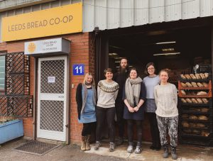 Members of the Leeds Bread Co-op standing outside the bakery premises