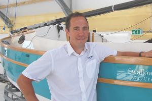 Matt Newland, director of Swallow Yachts, standing beside one of his bespoke boats