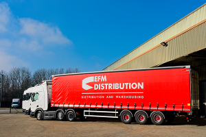 An EFM Distribution articulated lorry parked in the business's lorry yard