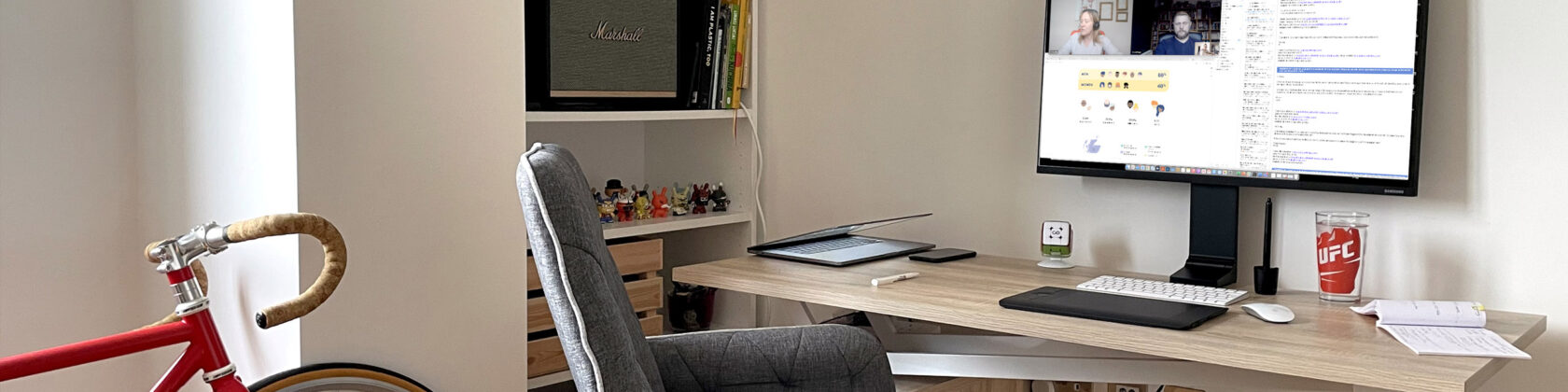 Home office with desk, computer monitor, chair and bicycle