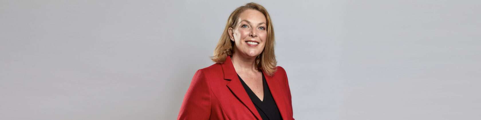 Portrait image of Judith Hartley on a grey background