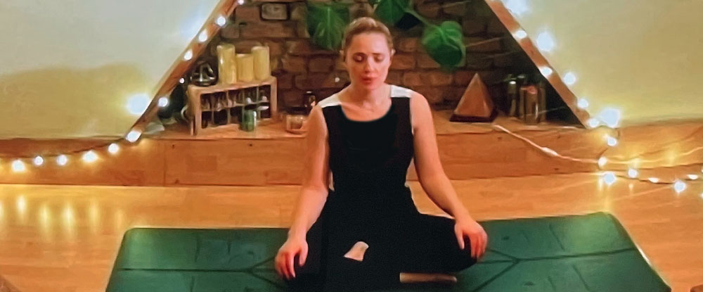 Female practising yoga technique and relaxation