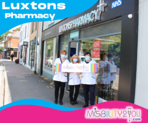 nurses in front of luxtons pharmacy