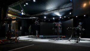 Dark TV Studio lit up with spotlights and cameras