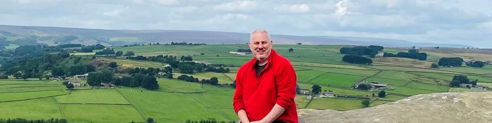 MIke Powell standing against a rural landscape