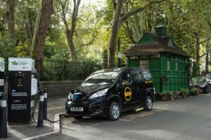 An electric London black cab charging its battery at a charging station